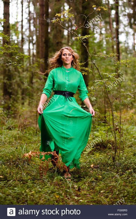 Running woman in long dress at forest Stock Photo, Royalty