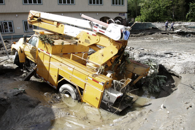 A truck lies in a hole created by the raging waters created by Tropical Storm Irene on Monday, Aug. 29, 2011 in Berlin, Vt. (AP Photo/Toby Talbot)