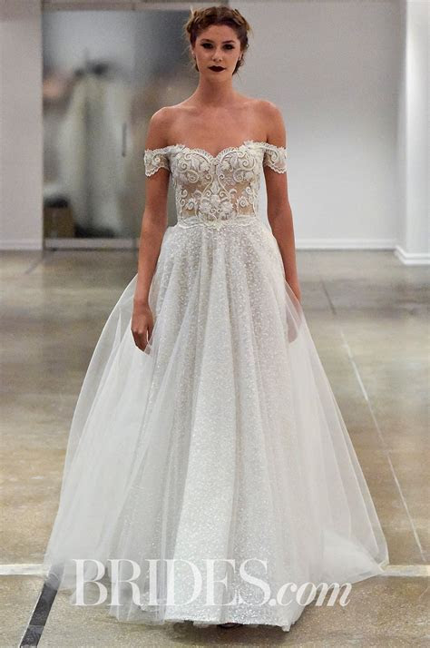 A pretty tulle layer is draped over the lace and beaded