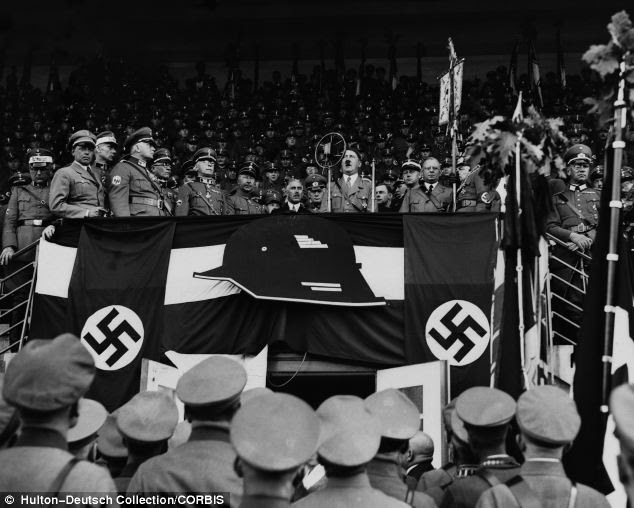 Infiltrate: Adolf Hitler speaks to a crowd of German soldiers at a large rally in Hannover