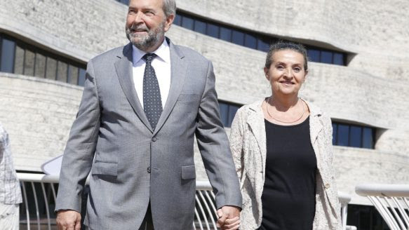 Tom Mulcair and his wife Catherine Pinhas arrive at the Museum of History in Gatineau, Que., for his campaign launch Sunday. A poll taken during the day shows his New Democrats have surged ahead of other parties in voter support.
