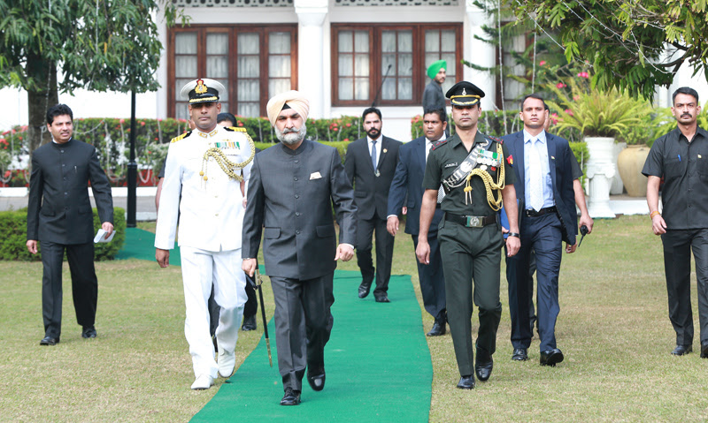 High Commissioner Taranjit Singh Sandhu inspecting a Guard of Honour presented by a contingent of the Border Security Force after unfurling the Indian National flag. Pictures by Sarath Peiris
