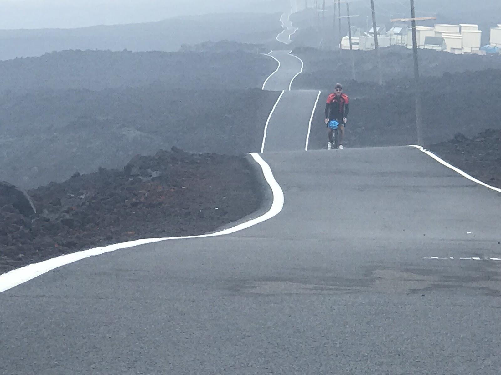 Bicycling longest road in the world - Mauna Loa Volcano - undulating roadway