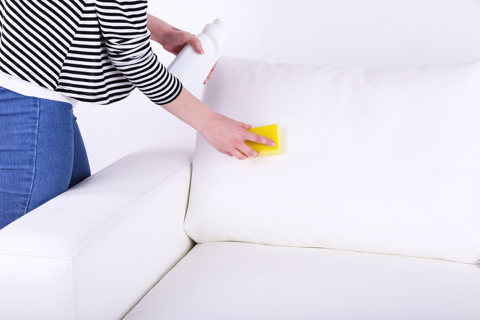 bigstock-Cleaning-white-sofa-65850382.jpg