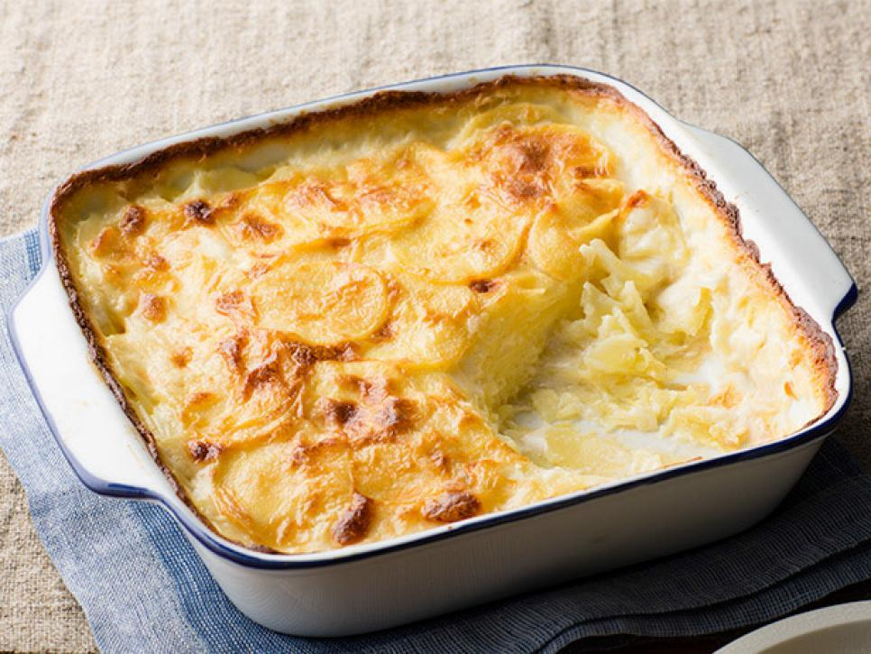 Description: https://food.fnr.sndimg.com/content/dam/images/food/fullset/2013/10/8/0/fnk_scalloped-potatoes_s4x3.jpg.rend.hgtvcom.966.725.suffix/1383780633985.jpeg