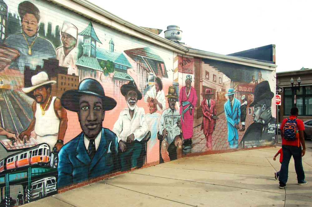 """""""Faces of Dudley"""" mural in Boston. (Greg Cook)"""