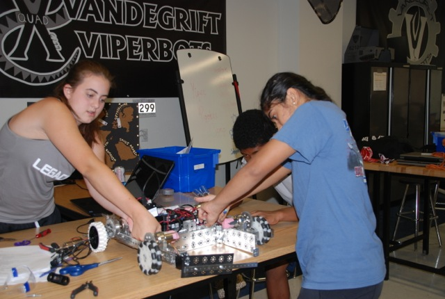 New ViperBots exercise precision teamwork during robot assembly.