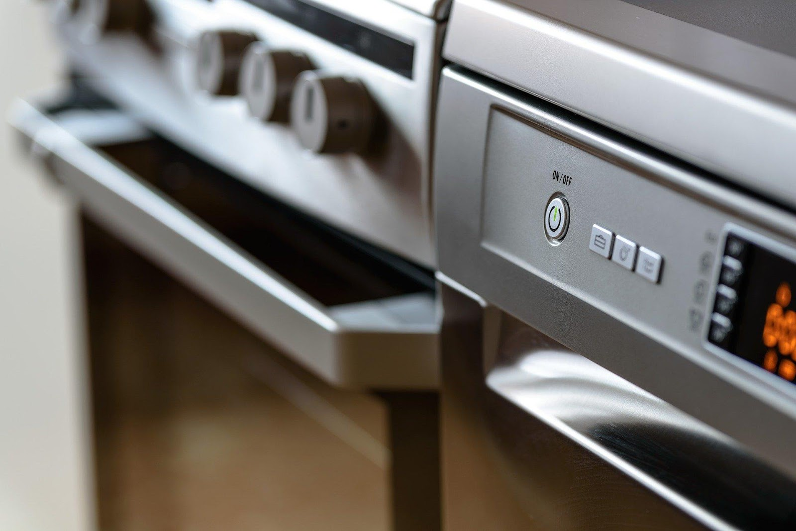 A picture containing indoor, sitting, oven, kitchen  Description automatically generated