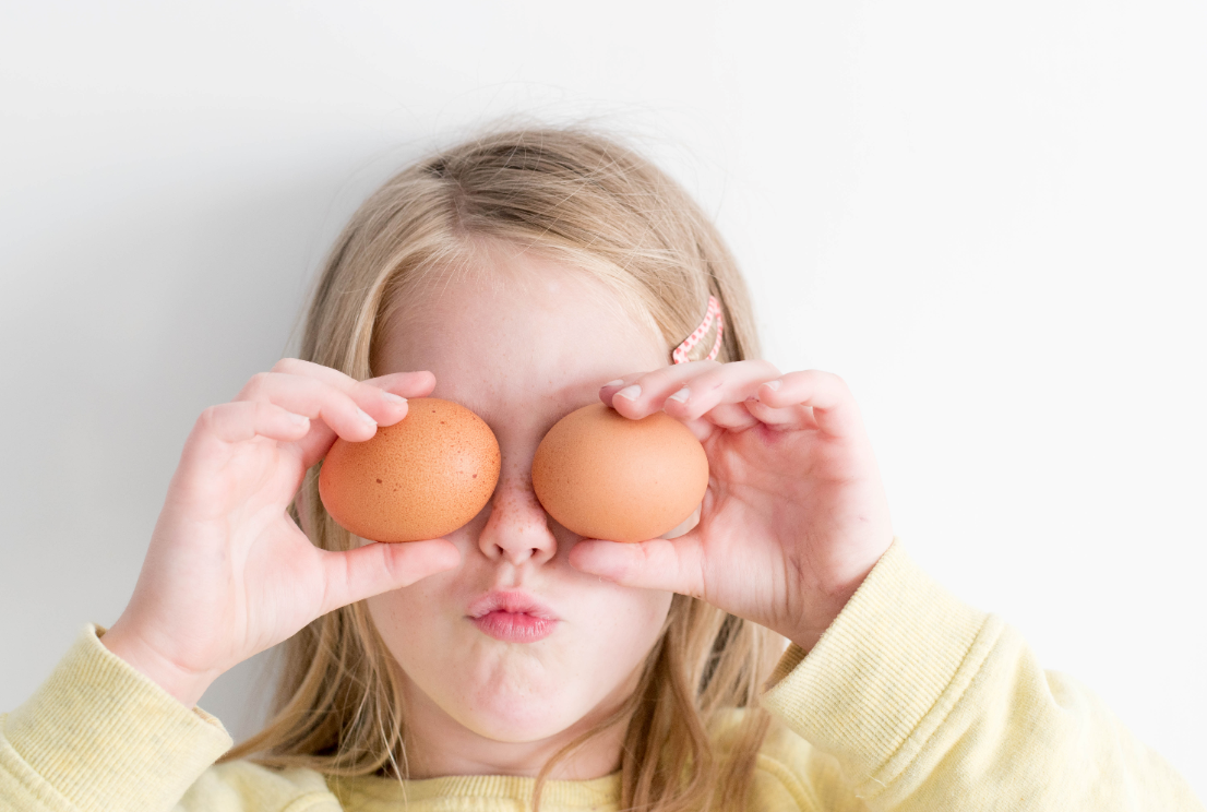 Kid playing with eggs