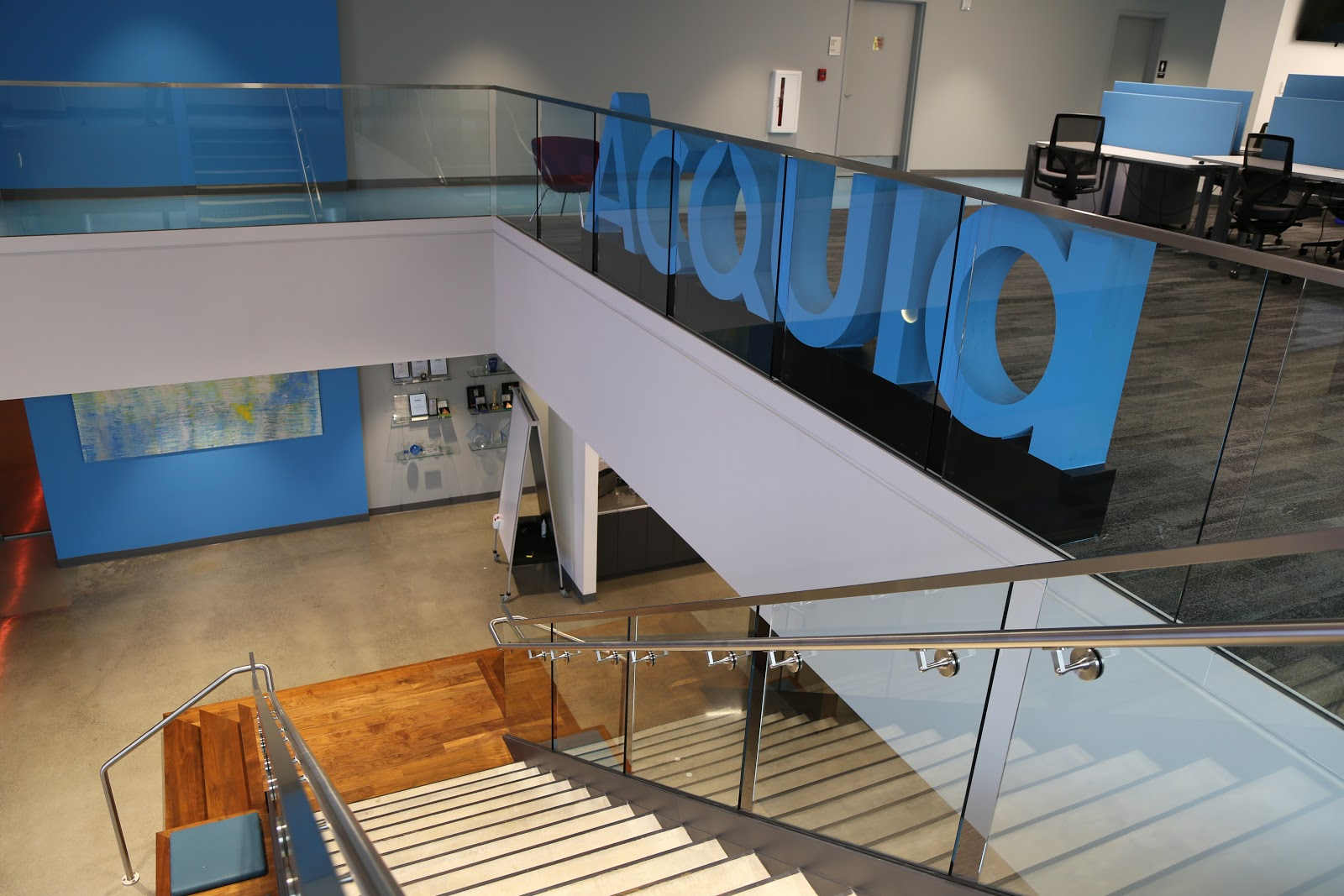 Acquia's office with its logo against a glass railing