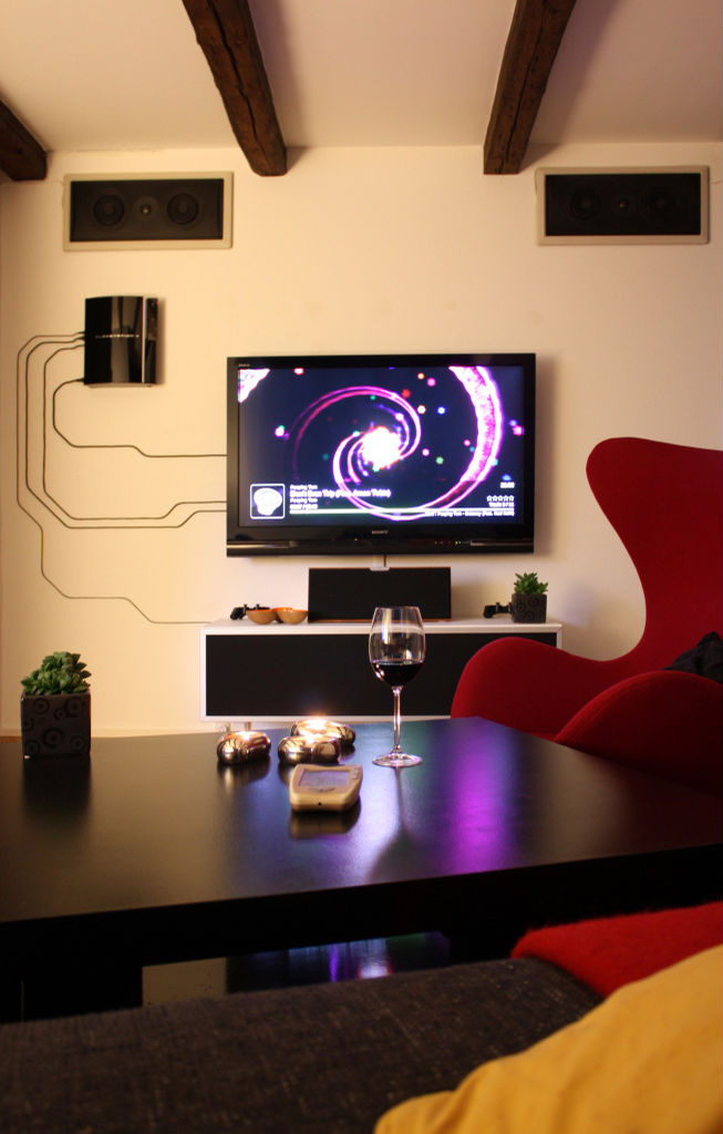 PS3 mounted on wall with cable art