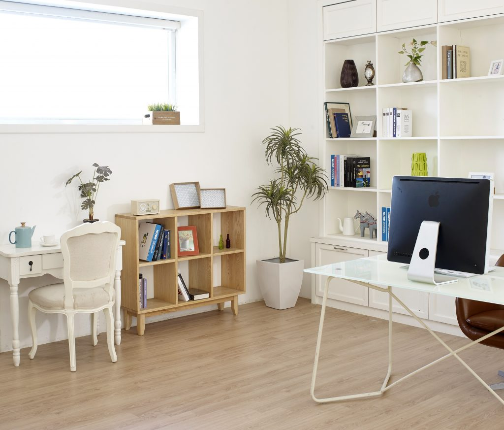 work station in a condo unit living room with bookshelves and table set
