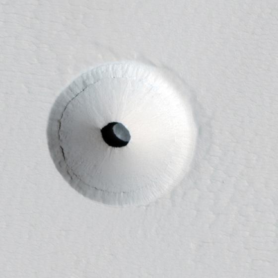 https://upload.wikimedia.org/wikipedia/commons/0/0d/Pavonis_Mons_lava_tube_skylight_crop.jpg