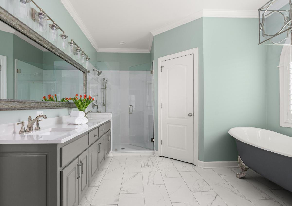 superior-construction-and-design-mt-juliet-tn-color-in-the-home-sea-foam-green-walls-bathroom-grey-vanity-claw-foot-tub