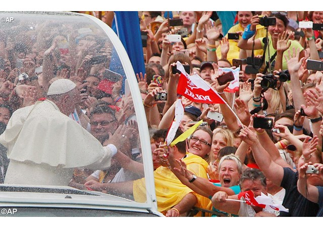 Pope Francis greets faithful and pilgrims on his way to the Royal Wawel Castle in Krakow - AP