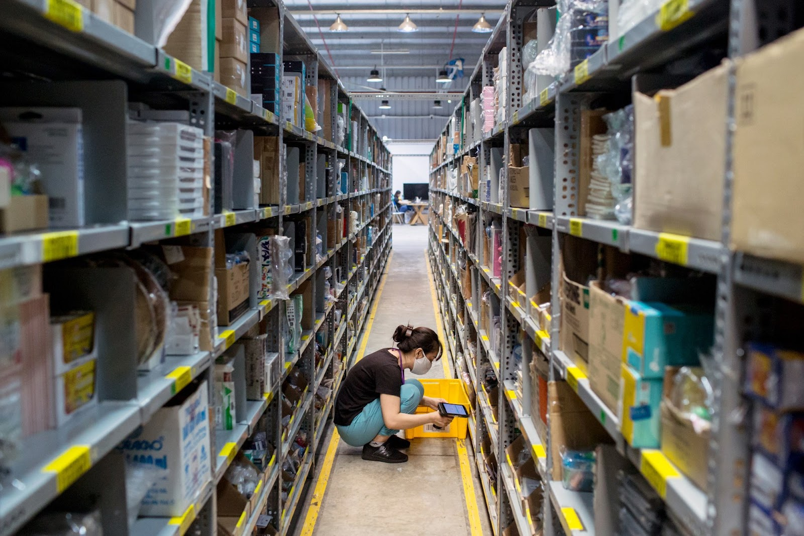 A worker scans and checks an item on the shelves of a Tiki.vn warehouse in Ho Chi Minh City, Vietnam, on May 24. Photo: Bloomberg