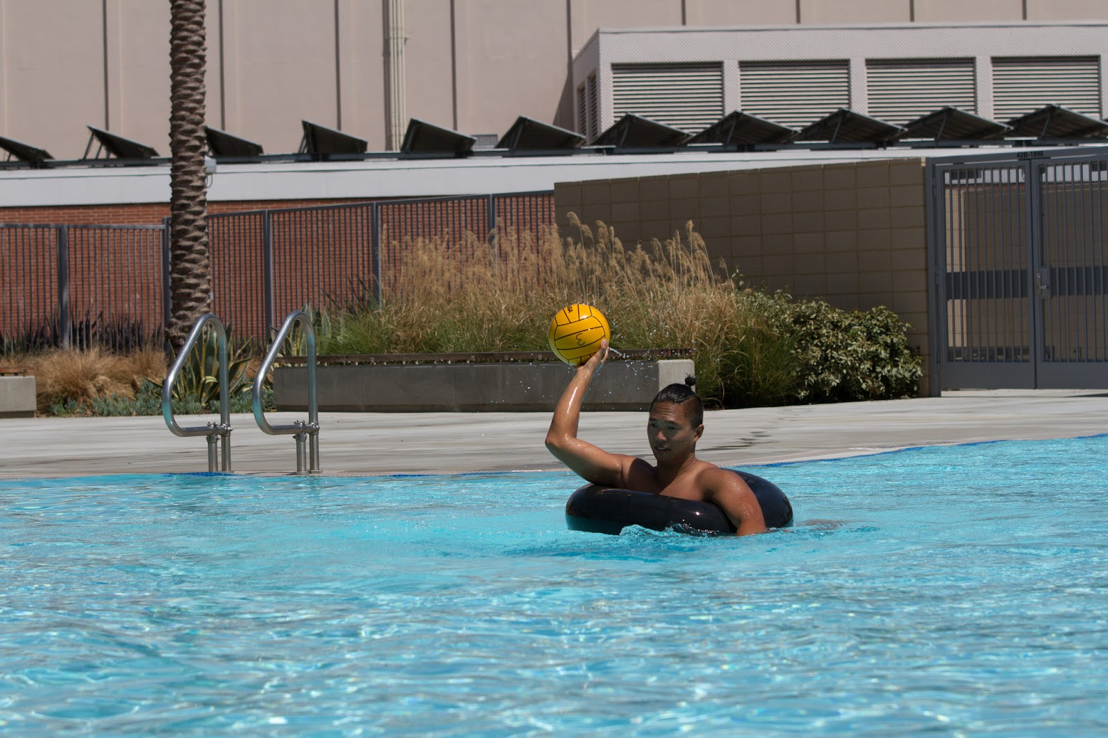 A young man enjoys inner tube water polo