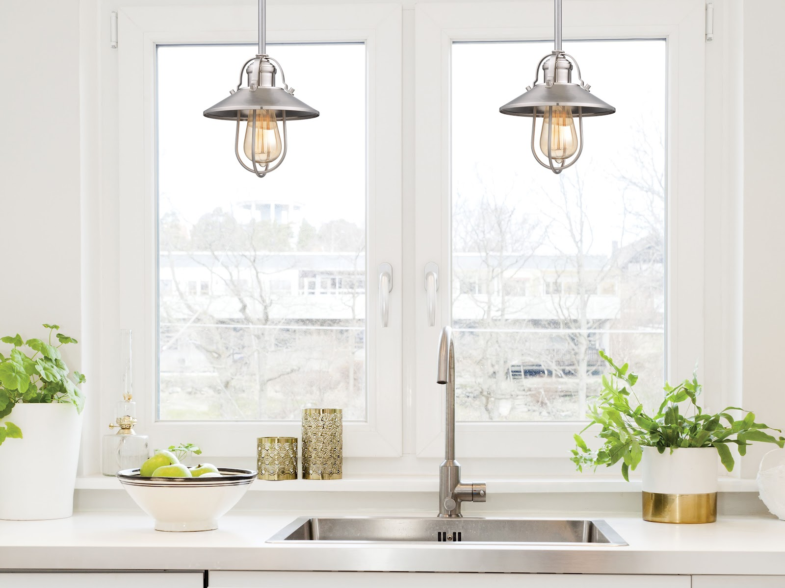 two mini pendants hang over a kitchen sink