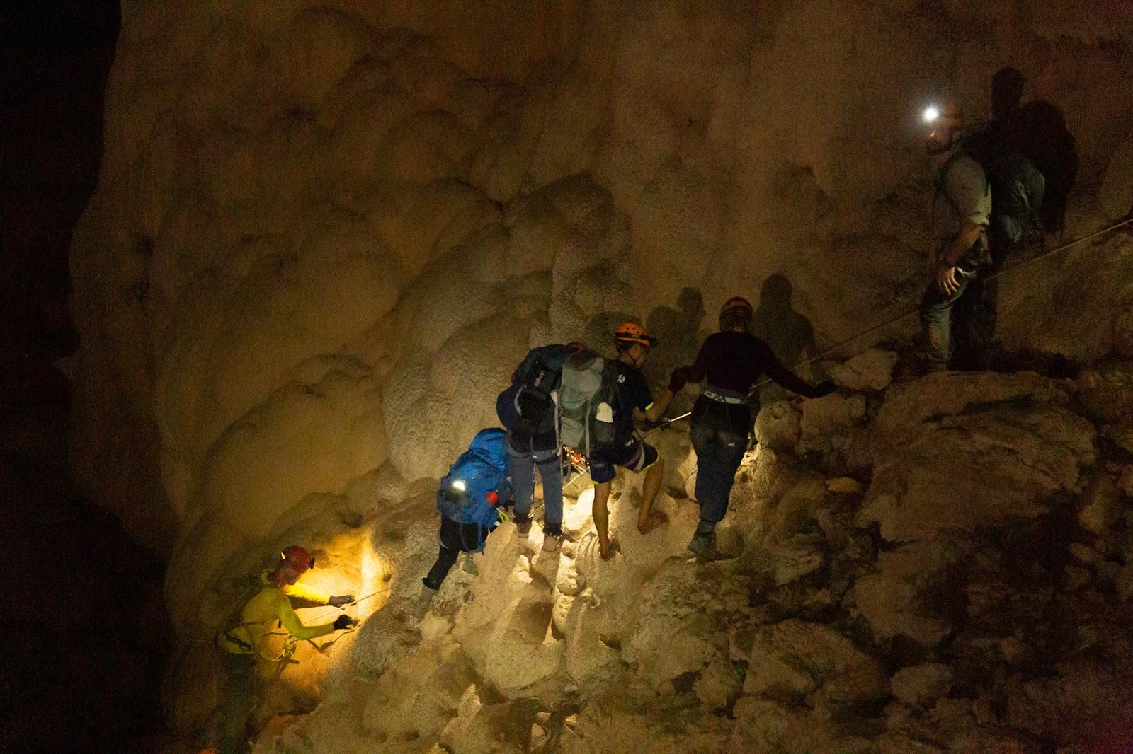 travelers exploring elephant cave
