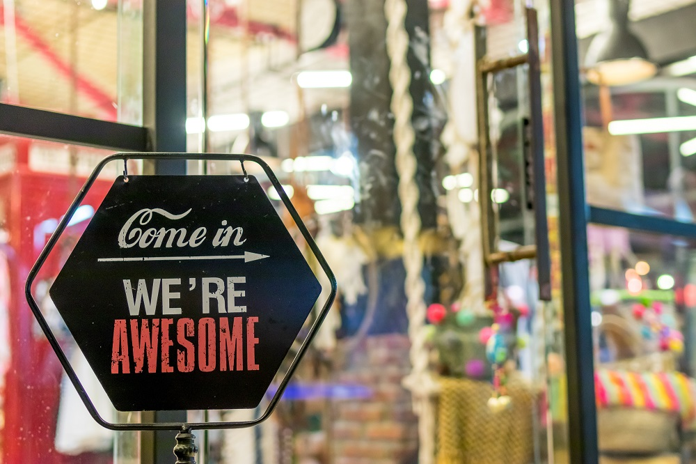 """sign on door saying """"come in, we're awesome"""""""