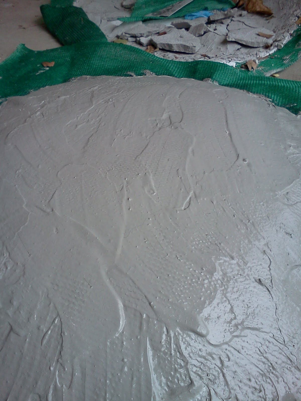 Close up of latex cement brushed onto 80% shade clothe