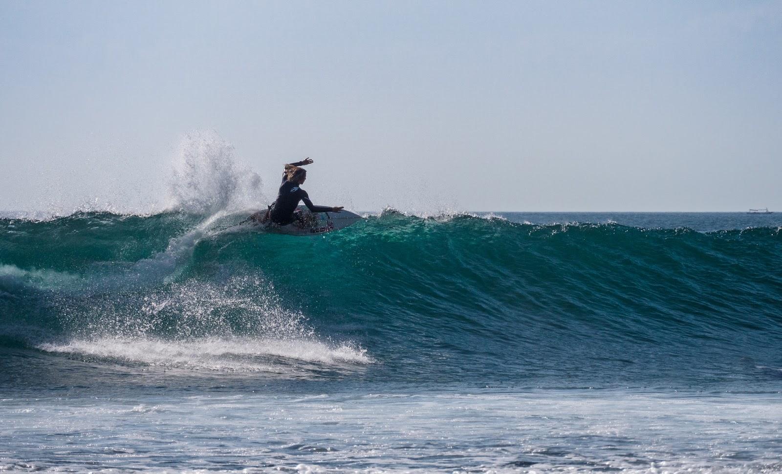 surfing in suluban beach