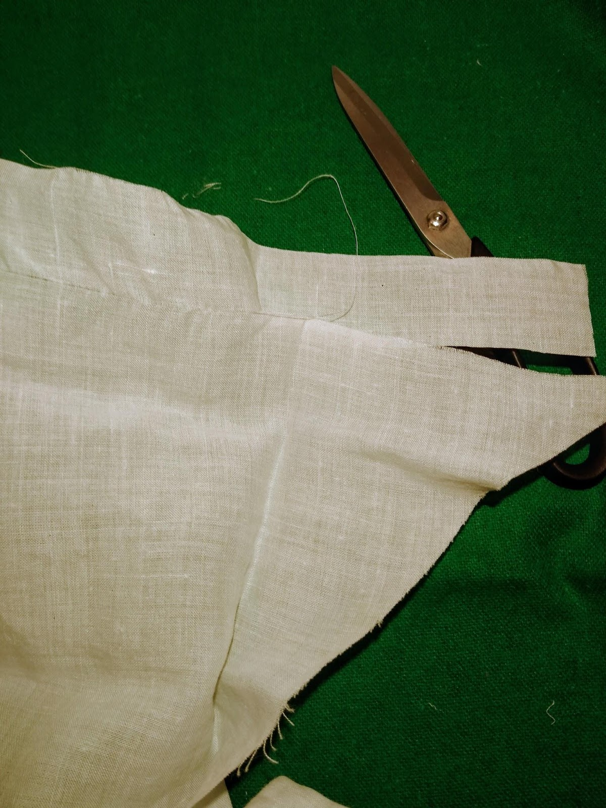 image shows a ruffle piece being created by pulling a thread and then following the channel created to cut a straight edge.