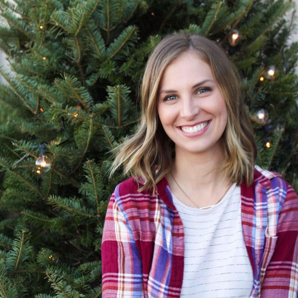 Kylie Hadden being stunningly beautiful in front of a Christmas tree