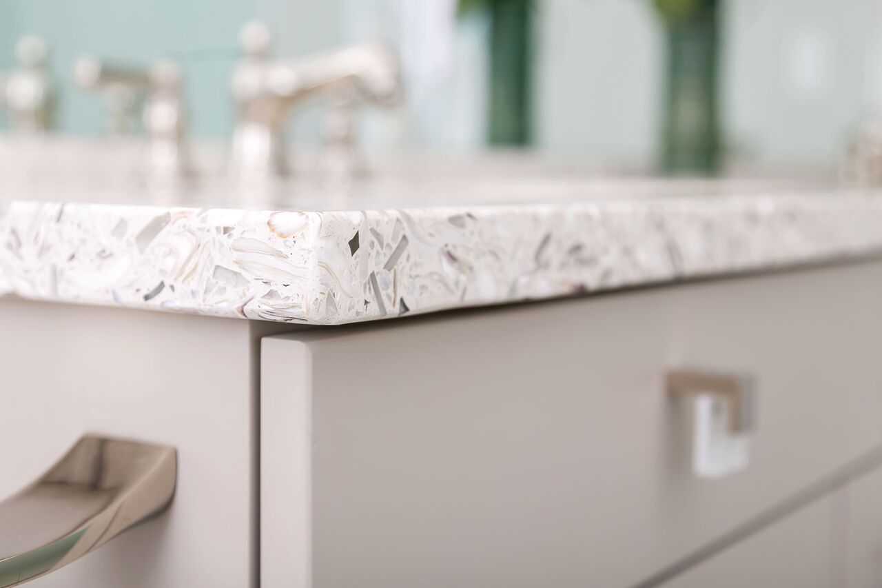Recycled glass counter tops for a coastal inspired bathroom remodel
