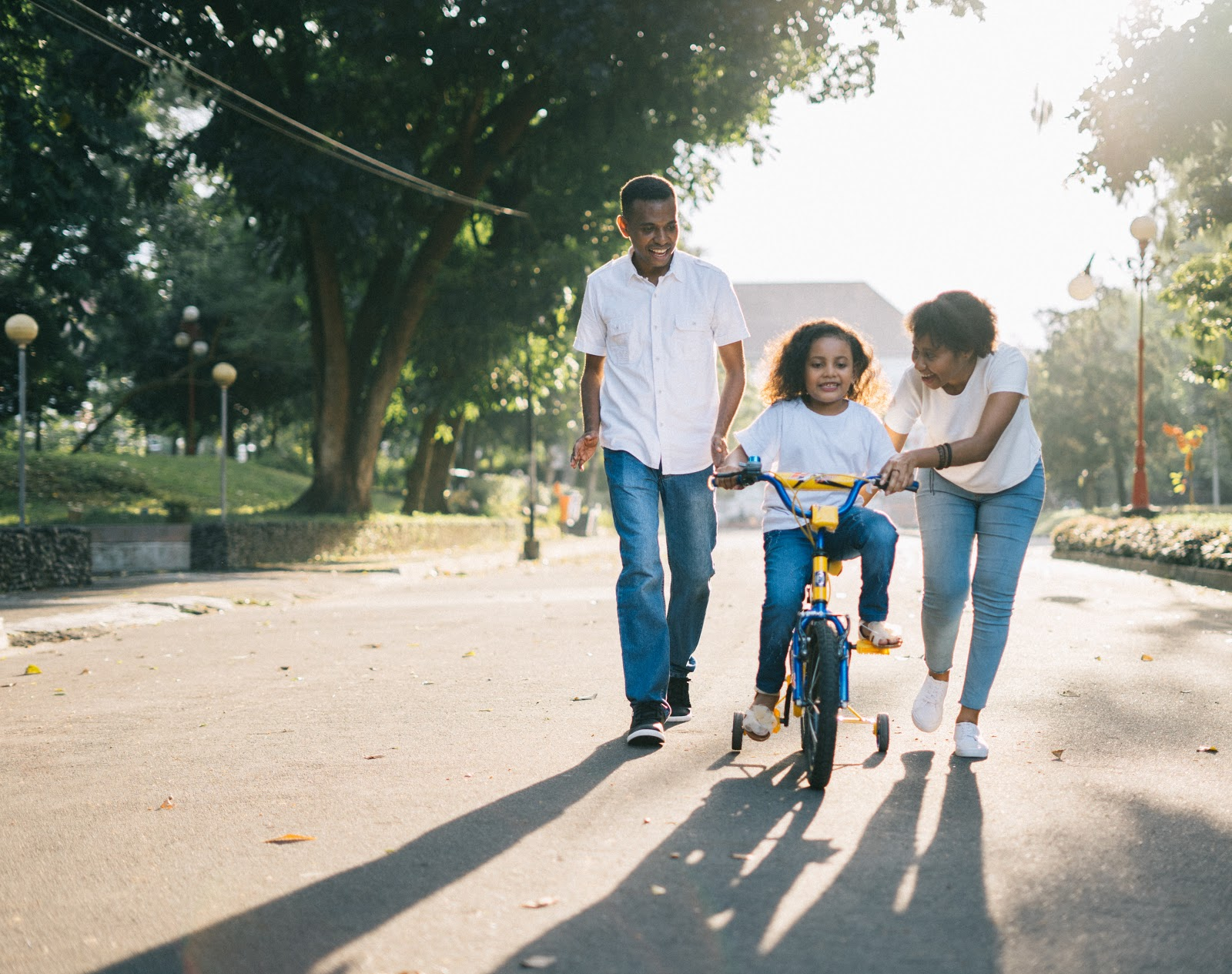 teaching daughter to ride a bicycle