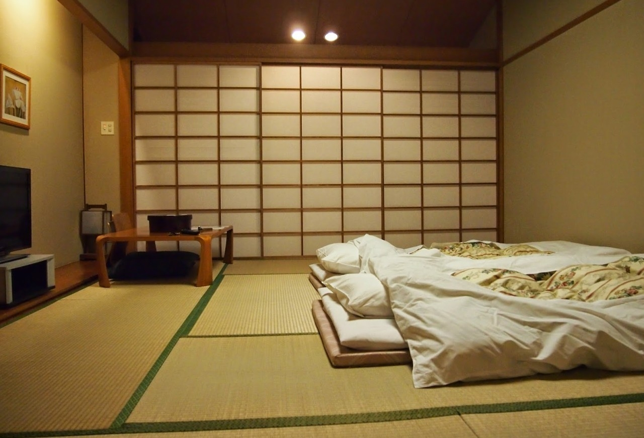 A Japanese bedroom with floor table and chair