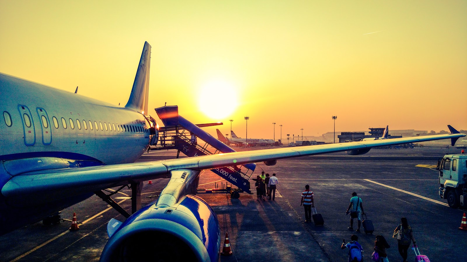 Boarding a Plane at Sunset - Cheap Airport Parking