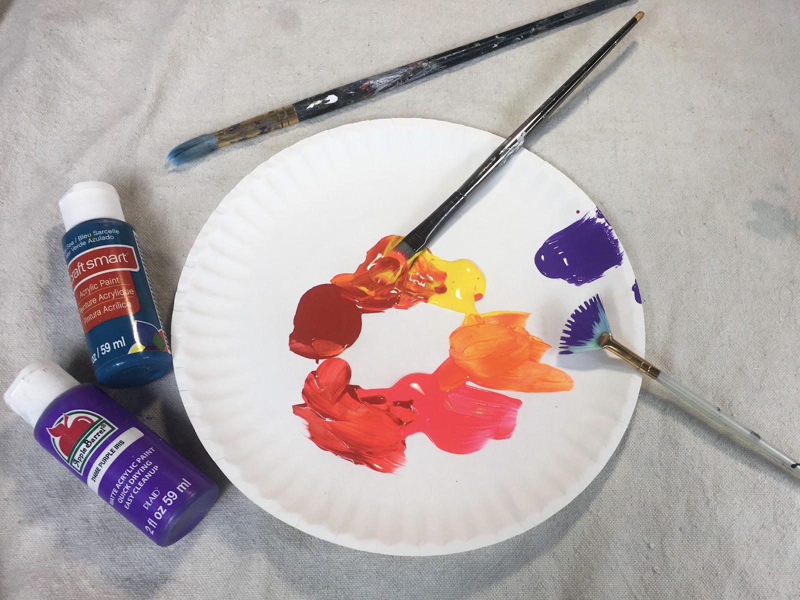 paint on a plate with paint brushes