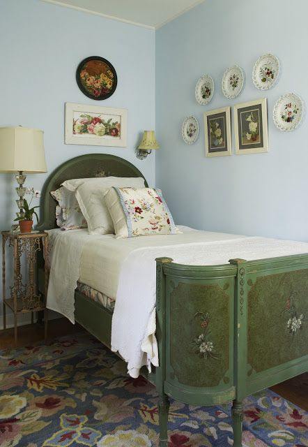 Vintage green bedframe with an antique nightstand