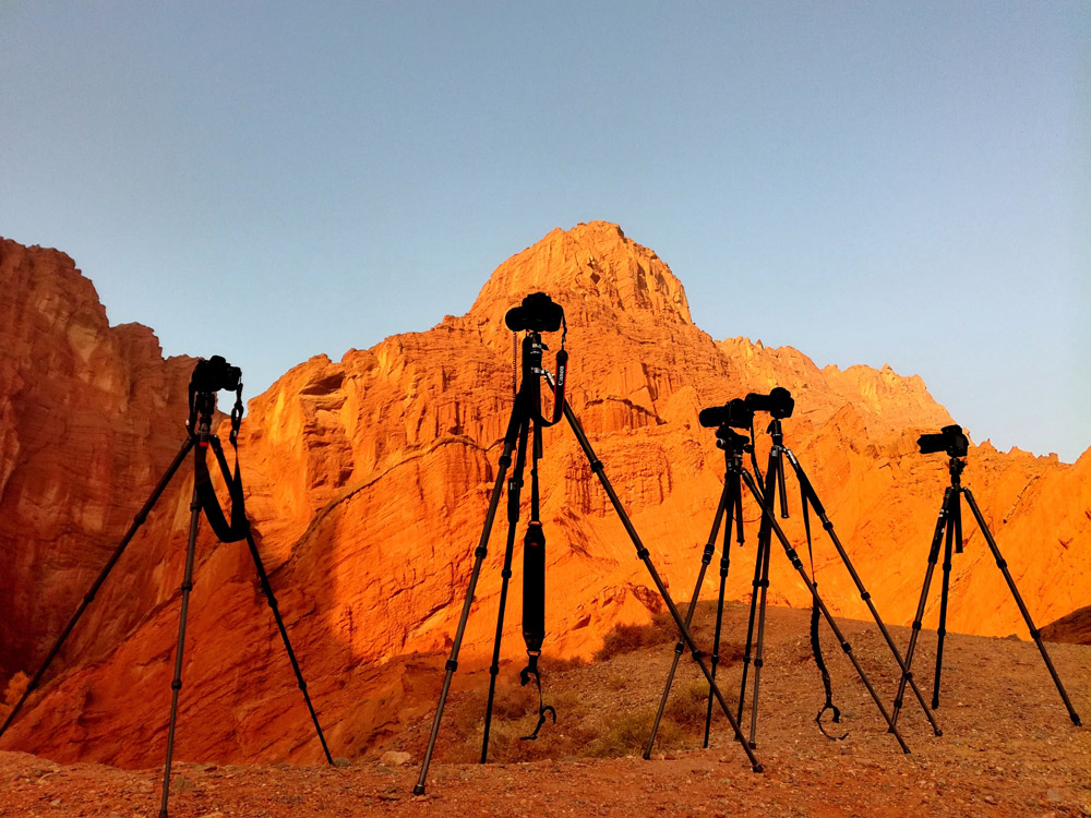multiple tripods with cameras