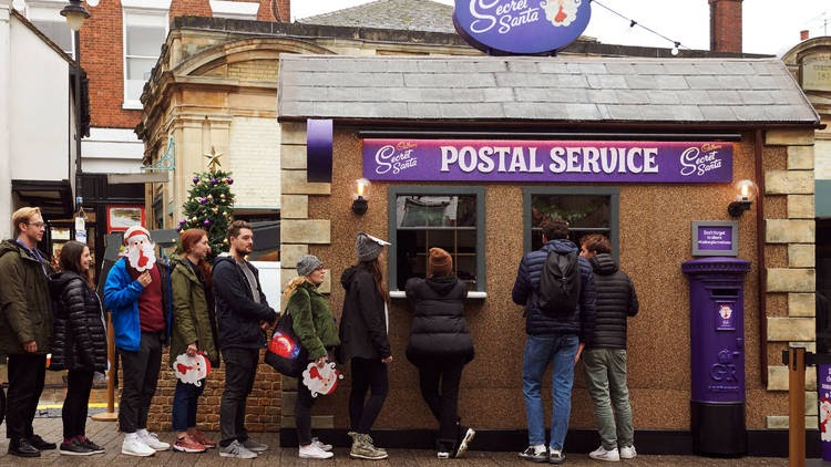 Cadbury's pop-up postal service with people waiting in line.