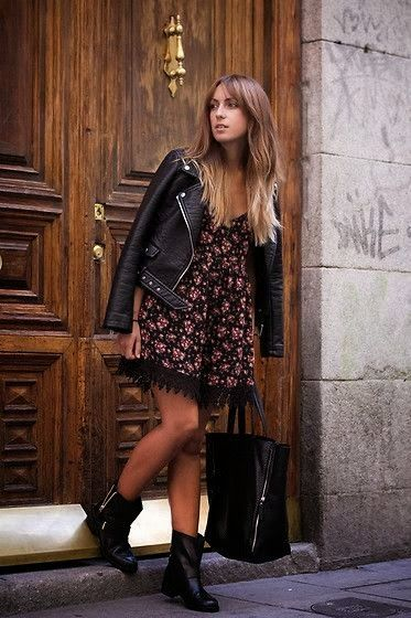 girl in a floral dress and petite leather jacket