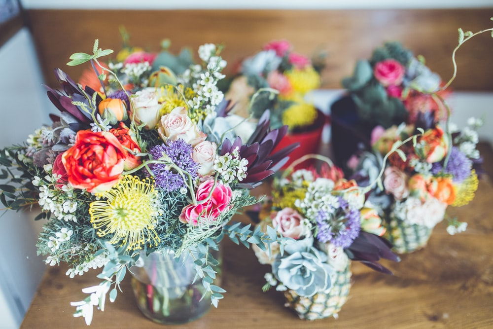 assorted-color petaled flowers centerpieces
