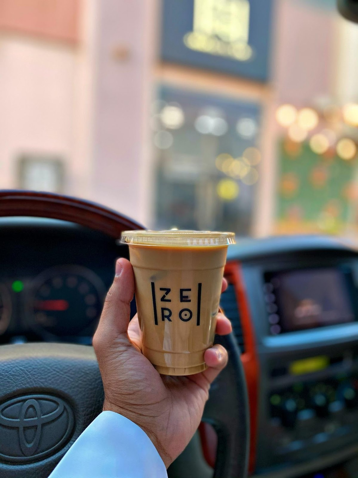 A person holding a cup of coffee  Description automatically generated with low confidence