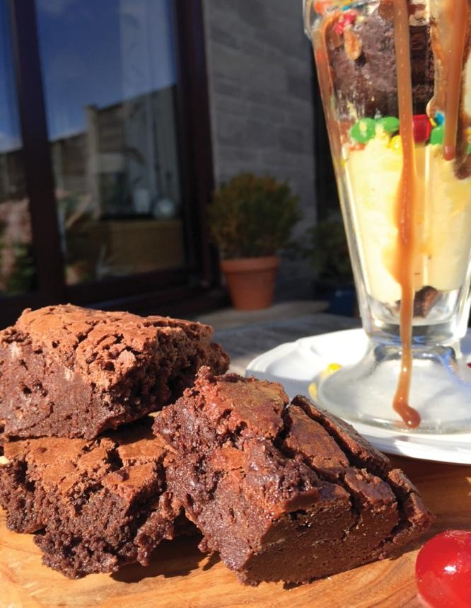 A picture containing cake, food, chocolate, piece Description automatically generated