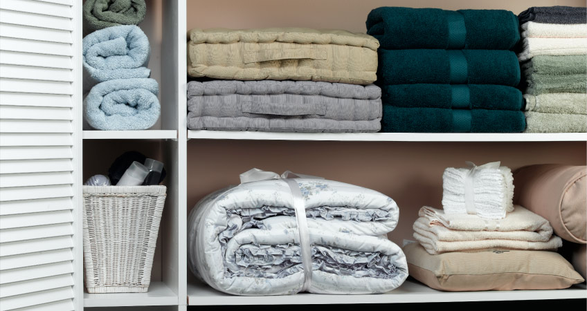 Organized linen closet with folded towels