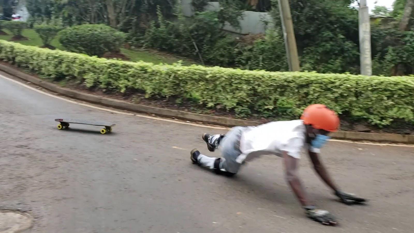 skateboarder falling, downhill skateboarding progression road map