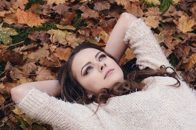 woman laying in leaves