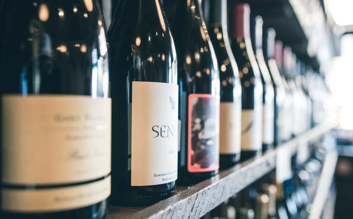 wine bottles on a store shelf