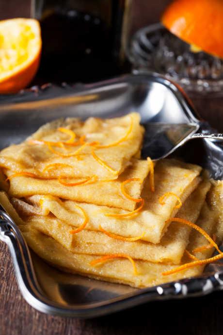 Flambé Desserts: Crepes Suzette is a classic dessert featuring crepes and orange sauce.