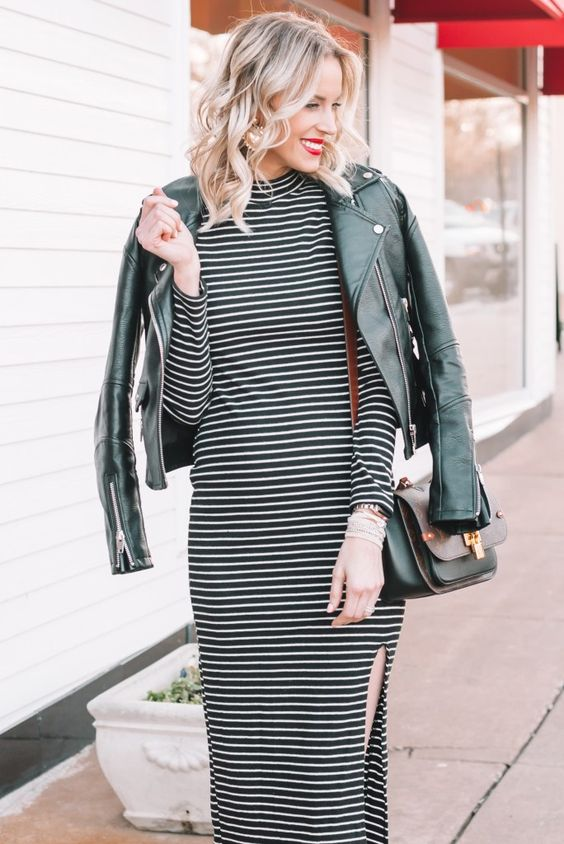 girl in a petite leather jacket and a dress