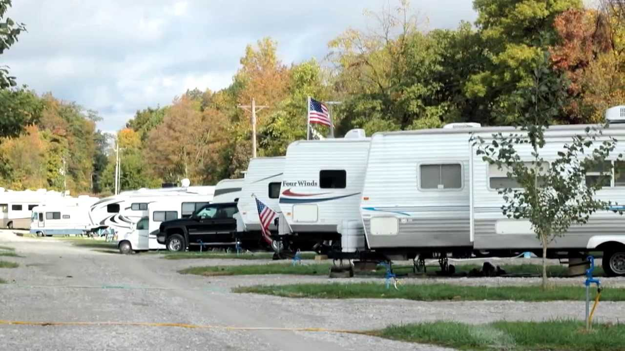 RVs parked at a campground in fall
