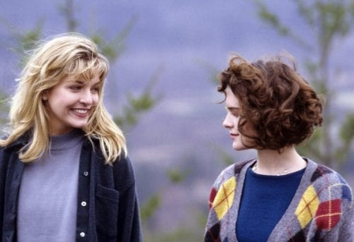 laura and donna smile at each other on a picnic