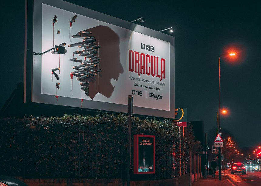 BBC Dracula billboard ad campaign with stakes and shadow of Dracula on the billboard.