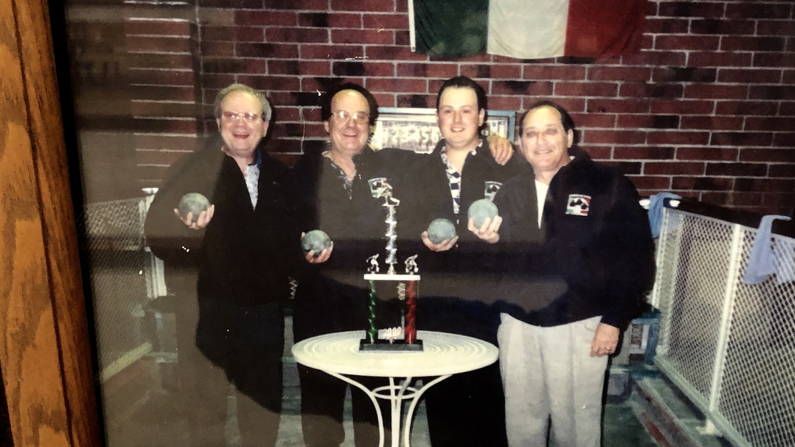 A photo of four happy bocce champions from the past.